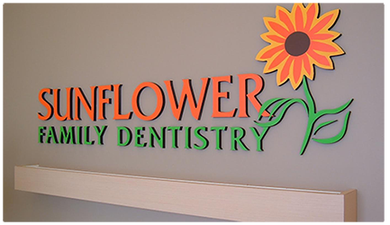Sunflower dentistry logo